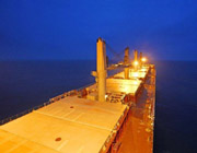 cargo_ship_dry_bulk_closeup_nighttime_lights_top.jpg