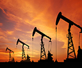 crude-oil-derrick-rigs-dusk