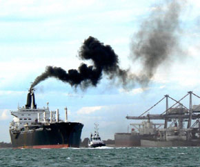 Image of a ship emitting fumes from a ship's funnel