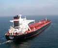 dry_bulk_vessel_open_sea_horizon_cloudy